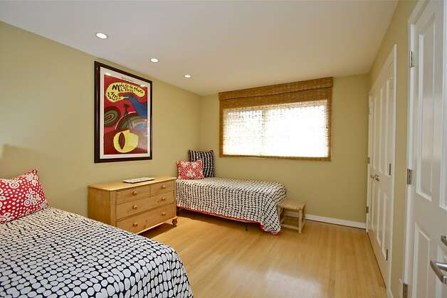 The three-bedroom home has cathedral ceilings and recessed lighting. Photo: Karin Larson Photography