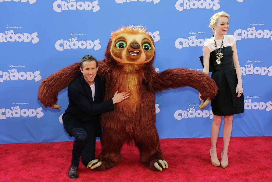 Actors Ryan Reynolds (L) and Emma Stone attend The Croods premiere at AMC Loews Lincoln Square 13 th