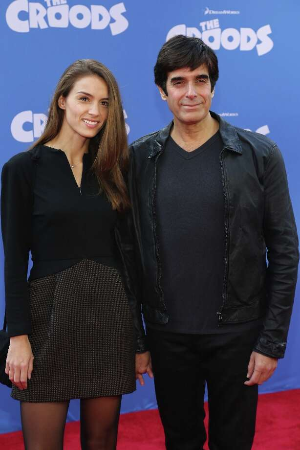 David Copperfield and Chloe Gosselin attend The Croods premiere at AMC Loews Lincoln Square 13 theater on March 10, 2013 in New York City. Photo: Neilson Barnard, Getty Images / 2013 Getty Images