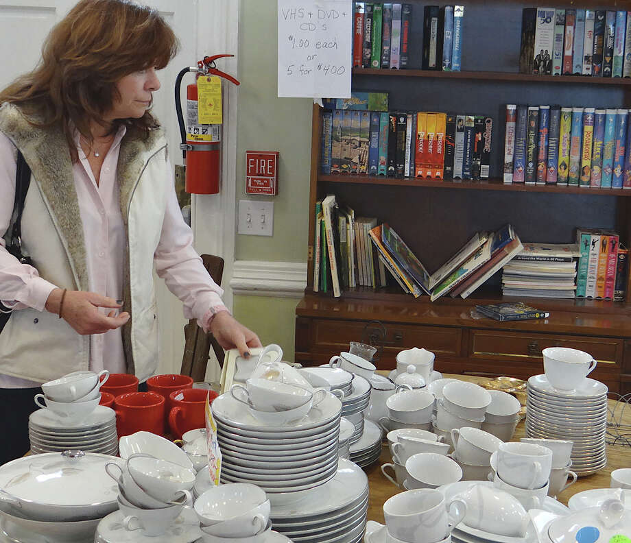 Mary Cash traveled with friends from Bayside, N.Y., to visit the Westport Woman's Club Curio Cottage Thrift Shop Tag Sale and other area attractions Saturday.  WESTPORT NEWS, CT 3/9/13 Photo: Mike Lauterborn / Westport News contributed