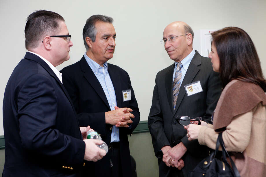 BIC president Chris Mills, left, and BIC CEO Mario Guevara, center left, speak with State Rep. Paul Davis and State Senator Gayle Slossberg at a 40th celebration for the BIC Lighter at the Milford, Conn. factory. on Monday,  March 11, 2013. Photo: BK Angeletti, B.K. Angeletti / Connecticut Post freelance B.K. Angeletti