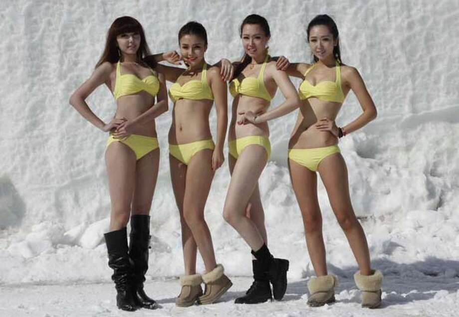 2013: Contestants posing in swimsuits during a beauty contest at a ski resort in Shenyang. Photo: STR, AP/Getty / AFP