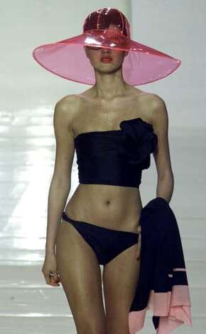 2001: A black swimsuit and a pink hat by Sonia Rykiel.  Photo: MICHEL EULER, AP/Getty / AP
