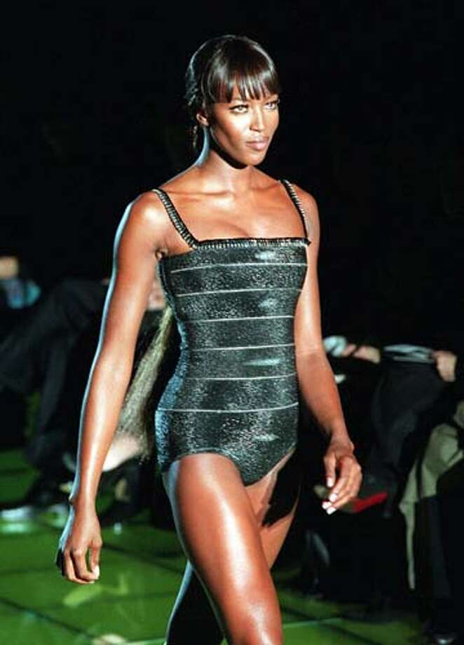1999:British top model Naomi Campbell shows a glossy swimsuit.  Photo: MICHEL EULER, AP/Getty / AP