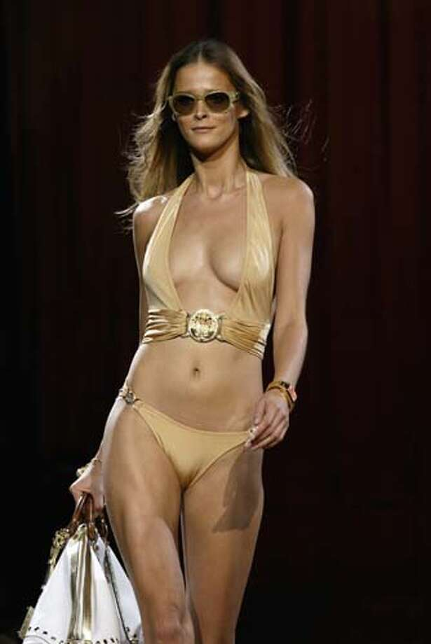 2005: A swimsuit ensemble from Versace  Photo: EVANS CAGLAGE, AP/Getty / DALLAS MORNING NEWS