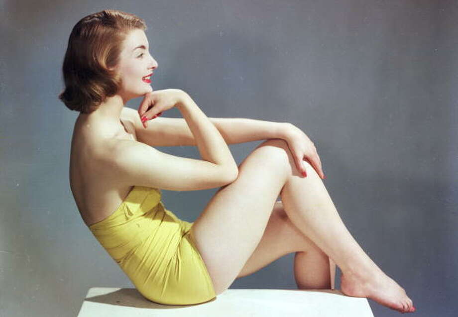 1957:  Model in a strapless yellow swimsuit. Photo: Chaloner Woods, Getty / Hulton Archive