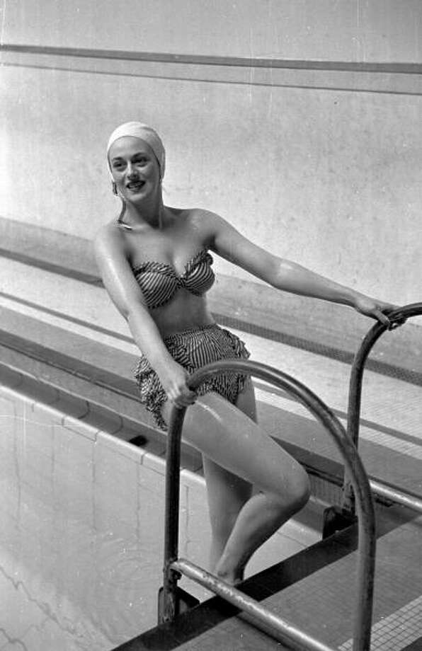 1949:  A woman modelling a new Slix swimsuit which is designed not to slip by using new molded material.  Photo: Haywood Magee, Getty / Picture Post