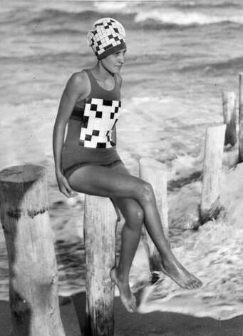 1933:  Verna Lee Fisher sporting her newly created crossword swimsuit with matching bathing hat. Photo: General Photographic Agency, Getty / Hulton Archive