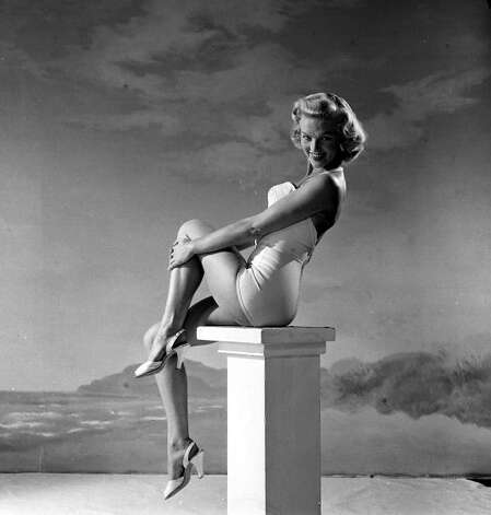 1955: Model and television and film actress Joyce Cooke poses for the camera wearing a swimsuit. Photo: Popperfoto, Getty / Popperfoto