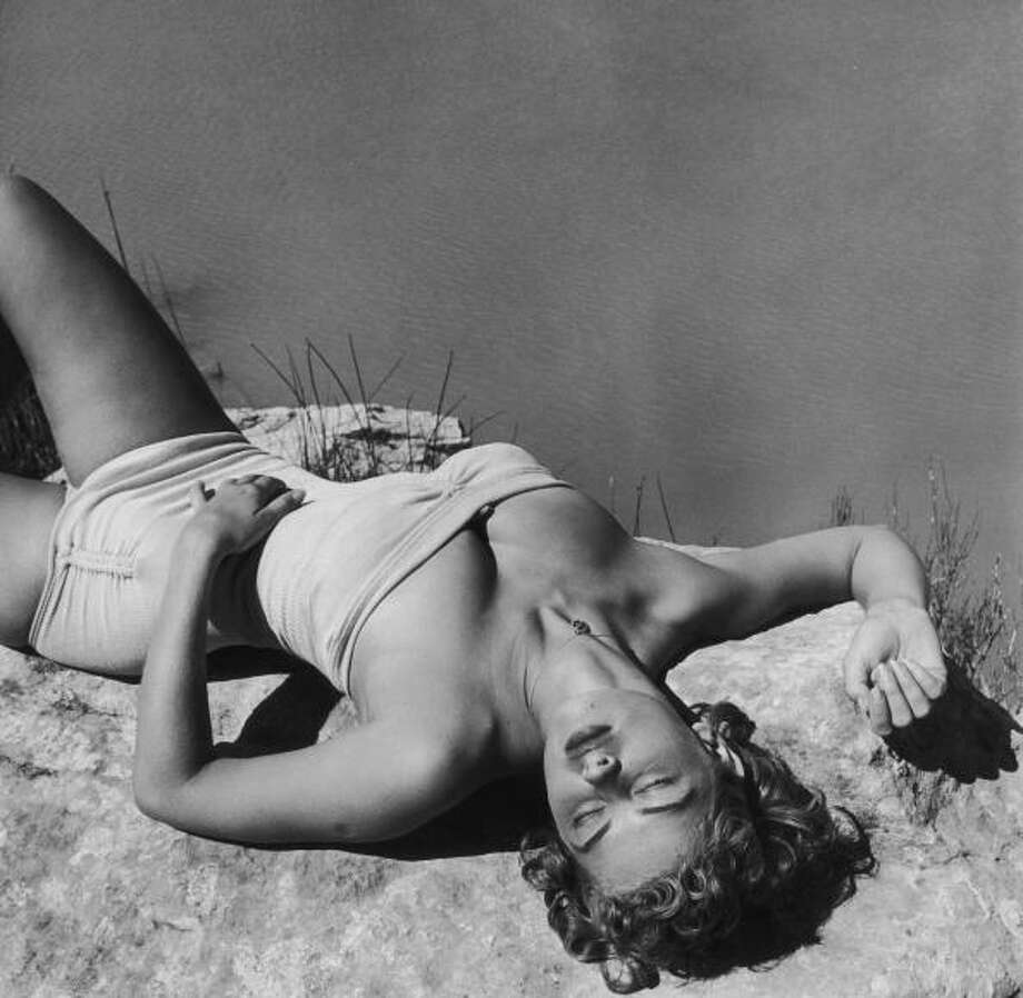 1952:A young woman sunbathing on a rock. Photo: Archive Photos, Getty / 2009 Getty Images