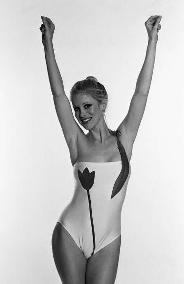 1980: LOS ANGELES, CA - 1980:  A model wears a sleek maillot tulip bathing suit by designer Keiko in this  Los Angeles, C1alifornia, studio photo shoot. Photo: George Rose, Getty / 1980 George Rose