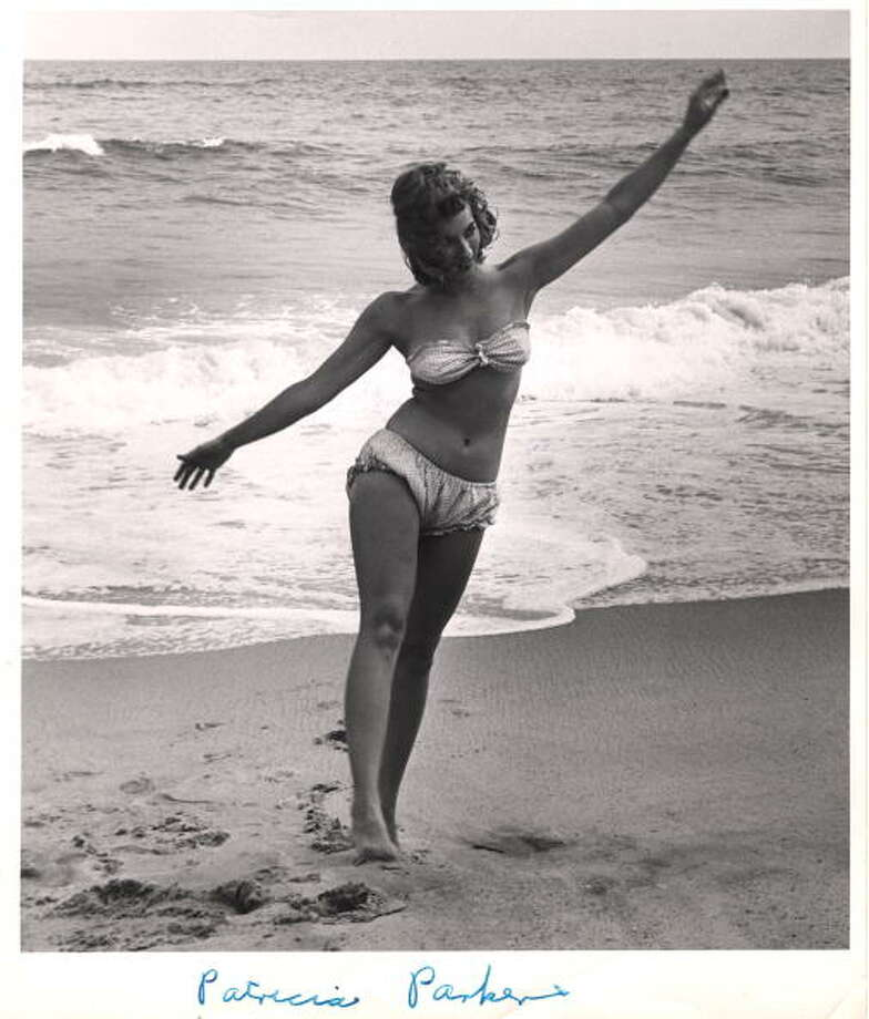 1940s or 1950s: Model Patricia Parker dances in a bikini on a beach. Photo: Weegee(Arthur Fellig)/Internatio, Getty / ICP
