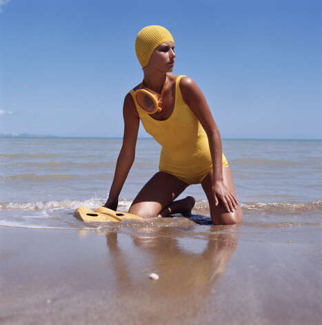 1975: A model wearing a yellow swimsuit with matching accessories on the beach. Photo: Archive Photos, Getty / 2011 Getty Images