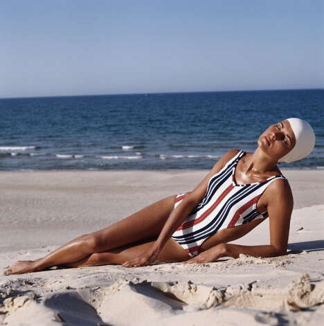 1973: A model wearing a striped cutaway swimsuit reclines on the beach. Photo: Archive Photos, Getty / 2011 Getty Images