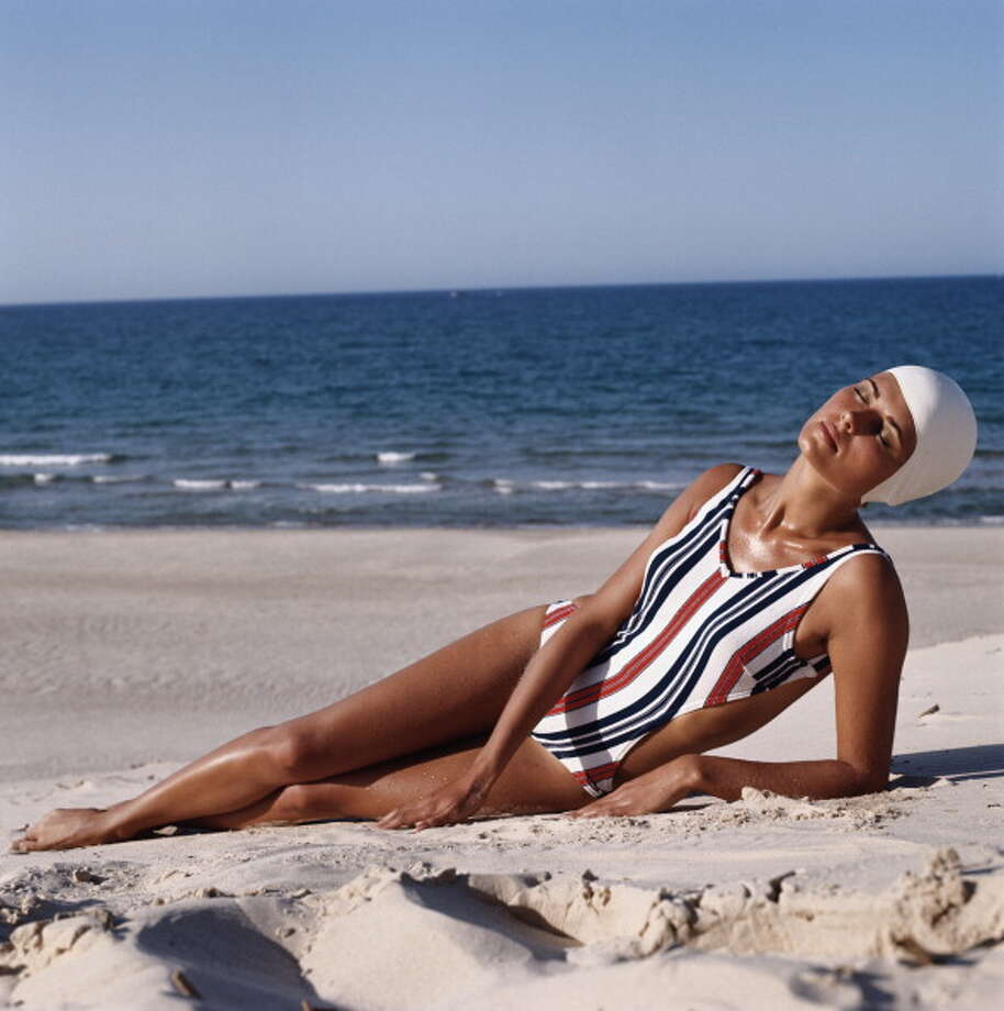 1973:A model wearing a striped cutaway swimsuit reclines on the beach. Photo: Archive Photos, Getty / 2011 Getty Images