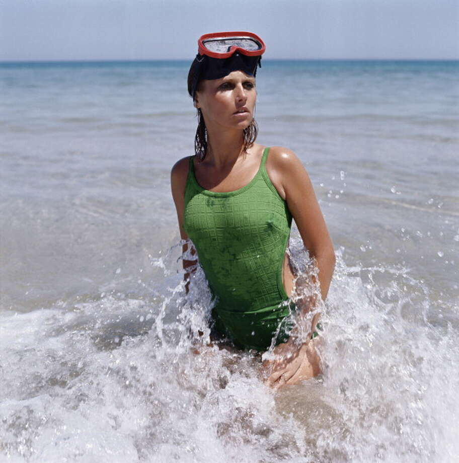 1973:A model wearing a green cutaway bikini on the beach. Photo: Archive Photos, Getty / 2011 Getty Images
