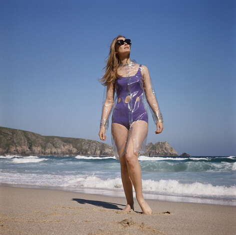 1965: A model wearing a cutaway swimsuit with a transparent waterproof cape over it. Photo: Jamie Hodgson, Getty / 2011 Jamie Hodgson