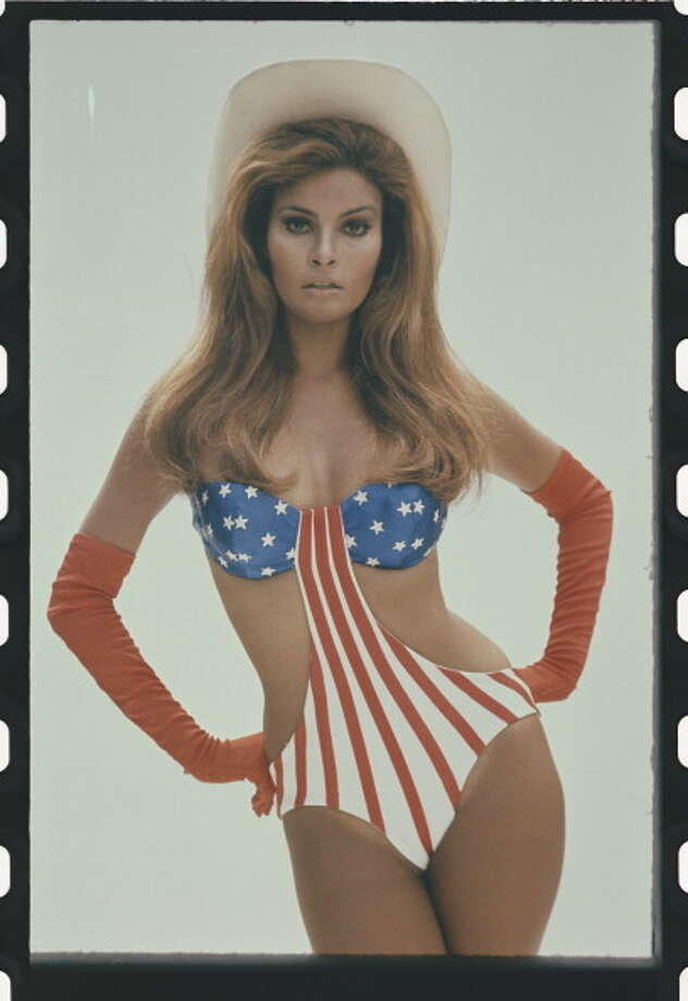 1970:American actress and sex symbol Raquel Welch poses in a stars and stripes swimsuit with cowboy hat and boots for the shot that became the movie poster for Myra Breckinridge. Photo: Terry O'Neill, Getty / Terry O'Neill