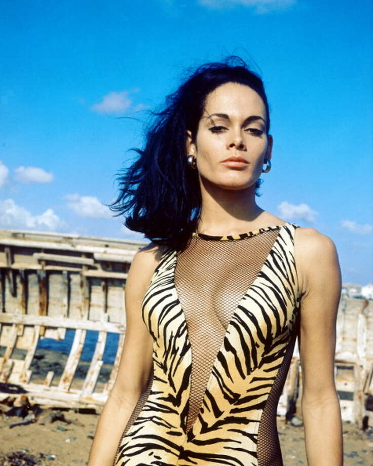 1965:Martine Beswick, British actress and model, wearing a tiger skin print swimsuit with fishnet cut-outs in a 'V' across the front as well as up the side. Photo: Silver Screen Collection, Getty / 2011 Silver Screen Collection