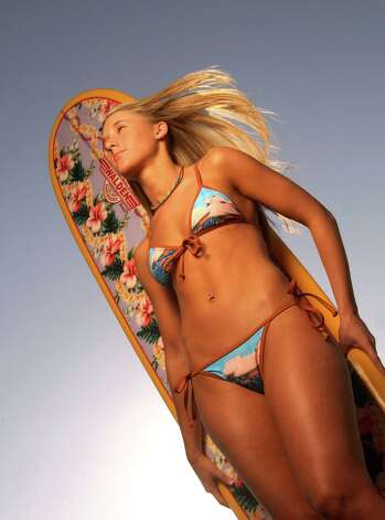 2003: Surfing inspired swimwear on the Seawall in Galveston. Photo: SMILEY N. POOL, Getty / HOUSTON CHRONICLE