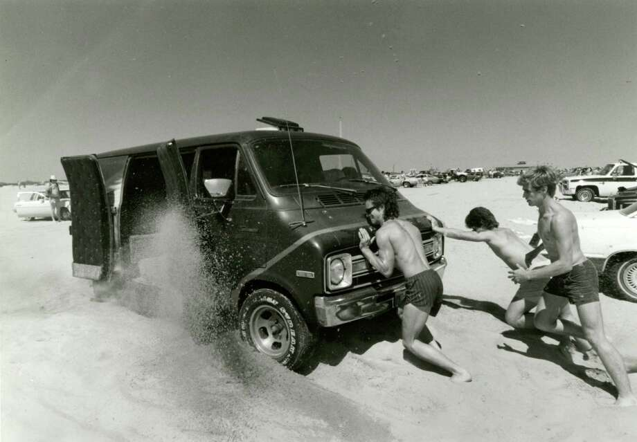 March 22, 1986:Beachgoers try to push a van out of the soft sand at the beach on Galveston Island. Photo: Timothy Bullard, Houston Chronicle / Houston Chronicle