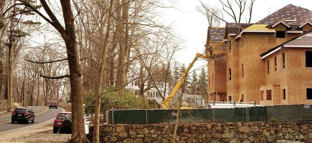 Affordable housing is under construction on Main Street Ridgefield, Conn. Monday, March 11, 2013. Photo: Michael Duffy / The News-Times