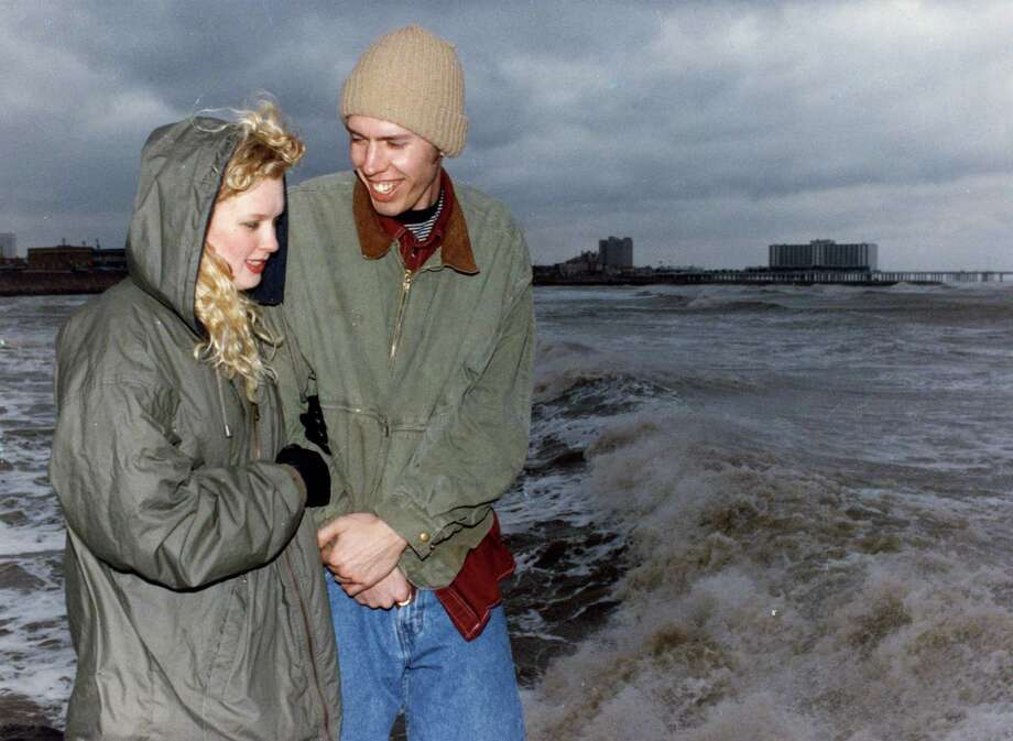 March 12, 1993: Nate Bogert and Heidi Schneider, both from Kansas City, Mo., and both students at Northwest Missouri State University at Maryville, Missouri, take a last look at the Gulf of Mexico from a jetty near 38th Street in Galveston before they depart early tomorrow morning ending their trip for Spring Break.  Photo: Michael Boddy, Houston Chronicle