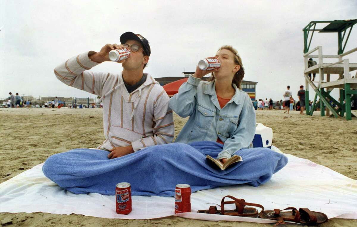 John Hollister, a graduate student from the University of Texas, did not let cold weather keep him and Rebecca Robker, a research technician from Baylor College of Medicine, from having their day at the beach. The advantage was that they had their pick of places to sit. March 21, 1992.