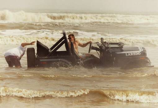 An unidentified would-be sailor tries to extract his jeep from the surf on West Beach Sunday where crowds of spring breakers finally got a glimpse of sunshine. March 17, 1991. Photo: Gaylon Wampler, Houston Chronicle