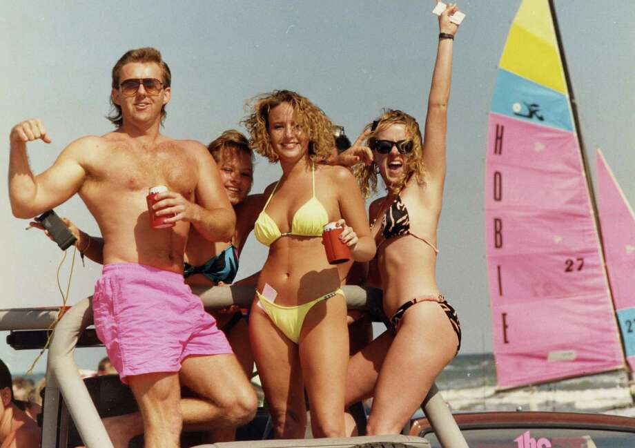 March 10, 1991:Unidentified revelers on Galveston's West Beach ride in the back of a pickup on a sunny, but brisk Sunday on the first weekend of Spring Break. Photo: Michael Boddy, Houston Chronicle