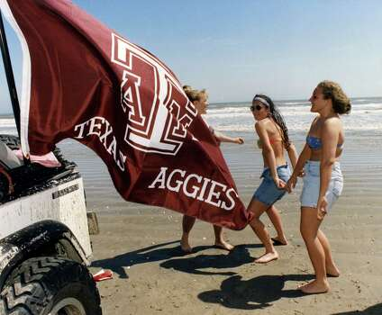Traci Bauer, left, Melissa Finnell and Erika Cupic, all Texas A&M students, dance in the spring break sunshine at 18 Mile Park beach in Galveston. March 17, 1993 Photo: Anna Marie Remedios, Houston Chronicle