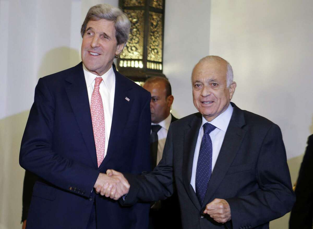 A letter writer says U.S. Secretary of State John Kerry (left, with Arab League Secretary General Nabil Elaraby) giving $250 million to Egypt was a poor choice since the U.S. is in financial crisis.