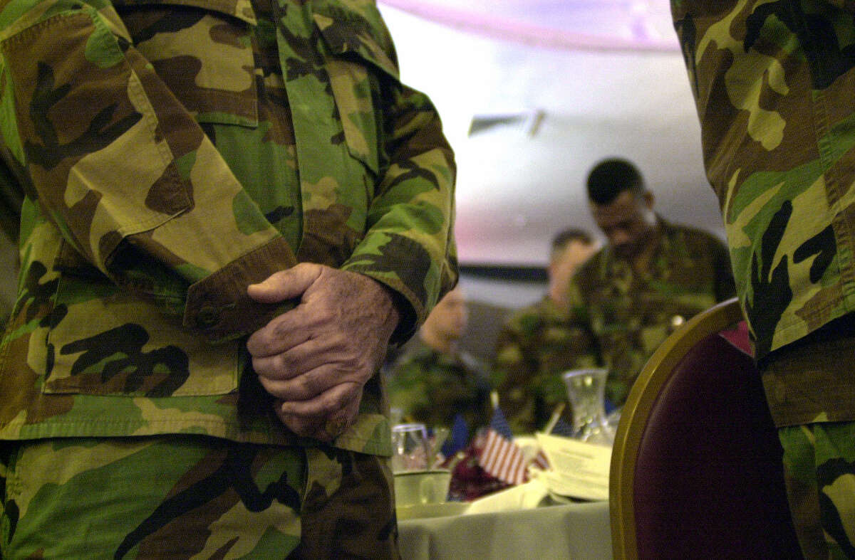 Soldiers at Fort Sam Houston join in the opening prayer during a National Prayer Breakfast observance.