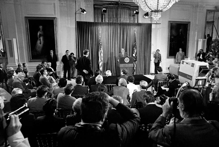 FILE – In this June 29, 1972, file photo reporters stand in an attempt to get President Richard Nixon's attention during a White House news conference in Washington during which Nixon said he'd sign legislation banning Saturday night specials.  Nixon called the news conference about six weeks after the shooting of George Wallace. Later that year the Senate did pass such a bill, but the House never acted on the legislation. Few presidents in modern times have been as interested in gun control as Nixon. Photo: File