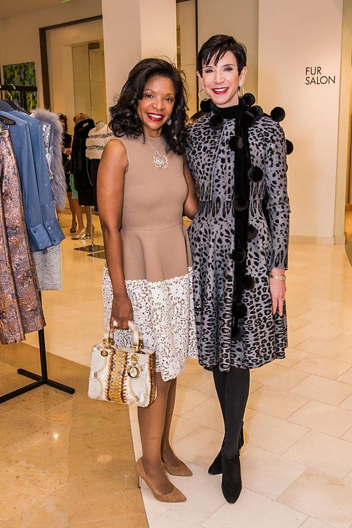 Vanity Fair introduced new rules for its International Best-Dressed List balloting, and contributor Amy Fine Collins (in black and gray Azzedine Alaia dress) came to a lunch at Neiman Marcus March 7, 2013, to let San Francisco's stylish set in on the details. Collins is seen here with arts patron Pamela Joyner in a beige Dolce and Gabbana dress.