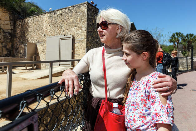 Gabby Sundberg (9) and her grandmother Carol Sundberg look into the elephant enclosure at the San Antonio Zoo on Monday, March 11, 2013.  Boo, a 59-year-old Asian elephant, was euthanized a day earlier after zoo officials determined her quality of life was gone.  Photo: MARVIN PFEIFFER, Marvin Pfeiffer/ Express-News / Express-News 2013