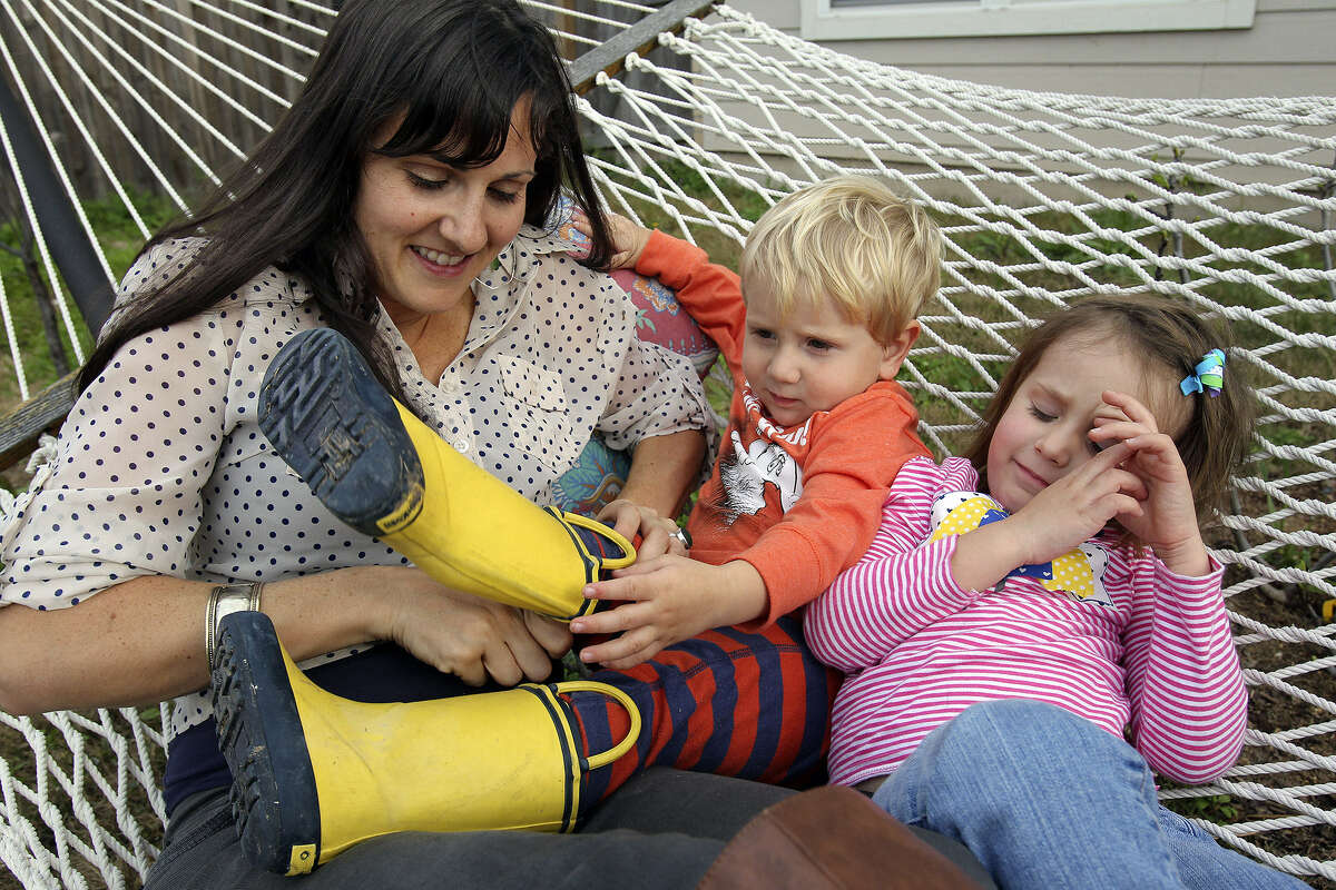 Emily Stringer of San Antonio combats the chaos of family life by slowing down and spending time with her children, Charlie, 2, and Lilah, 4.