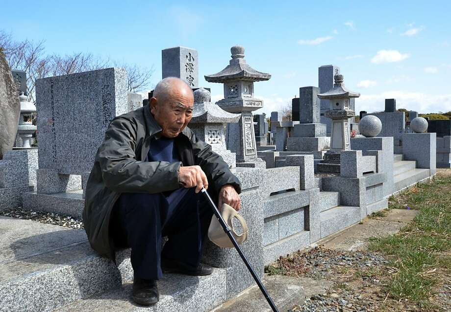 An elderly man sits as he and with his wife (not pictured) visit a cemetery to pay respects to their son who was killed in the March 2011 tsunami, in Minamisoma in Fukushima prefecture on March 11, 2013. March 11, 2013 marks the second anniversary of the 9.0 magnitude earthquake that sent a huge wall of water into the coast of the Tohoku region, splintering whole communities, ruining swathes of prime farmland and killing nearly 19,000 people.  Photo: Yoshikazu Tsuno, AFP/Getty Images