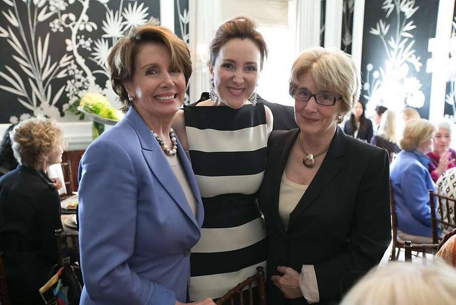 Nancy Pelosi and domestic violence activist Esta Soler (pictured to the left and right of Hashemi), Photo: David Washburn