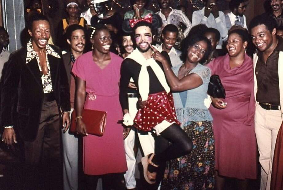 Revelers at a 1977 Halloween party embody the spirit of community in the Castro exhibition. Photo: GLBT Historical Society S.F.