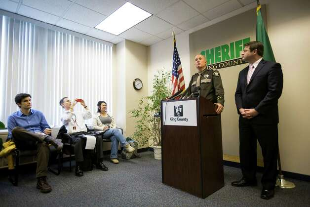 King County Sheriff John Urquhart, center right, shadowed by King County Council member Regan Dunn, answers questions from media regarding the ongoing manhunt for double murder suspect, Michael Boysen, on Monday, March 11, 2013, at the King County Courthouse in Seattle. Boysen, who killed his grandparents, also made threats against law enforcement and is trying to get weapons to kill citizens, corrections officers and police, Urquhart said Monday afternoon. Photo: JORDAN STEAD / SEATTLEPI.COM