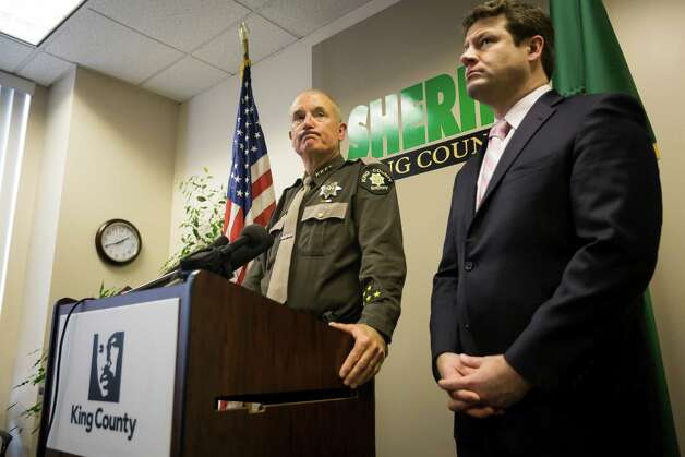 King County Sheriff John Urquhart, left, shadowed by King County Councilman Regan Dunn, right, answers questions from media regarding the manhunt for double murder suspect, Michael Boysen, on Monday, March 11, 2013, at the King County Courthouse. Photo: JORDAN STEAD / SEATTLEPI.COM