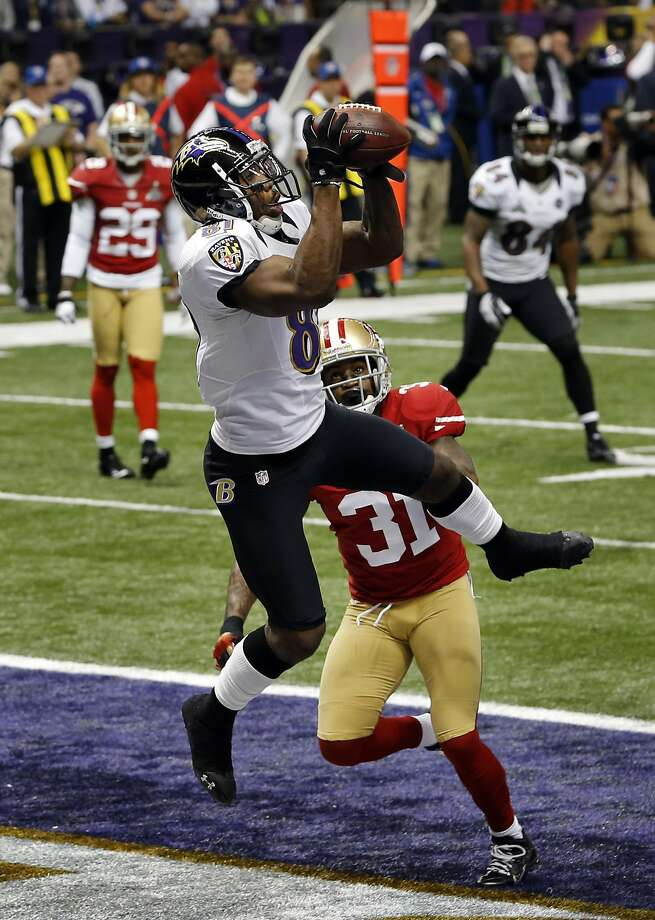 Anquan Boldin leaps over the 49ers' Donte Whitner for the first score in Super Bowl XLVII. Photo: Carlos Avila Gonzalez, The Chronicle
