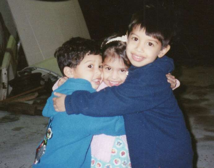 Then: The Tovar siblings have always been close, as evidenced by this first photo, taken in 1