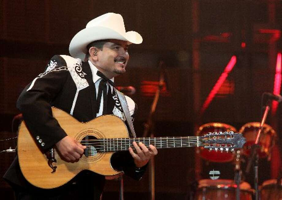 Los Invasores de Nuevo Leon perform during the Houston Livestock Show and Rodeo at Reliant Stadium on Sunday, March 10, 2013, in Houston. ( Mayra Beltran / Houston Chronicle )