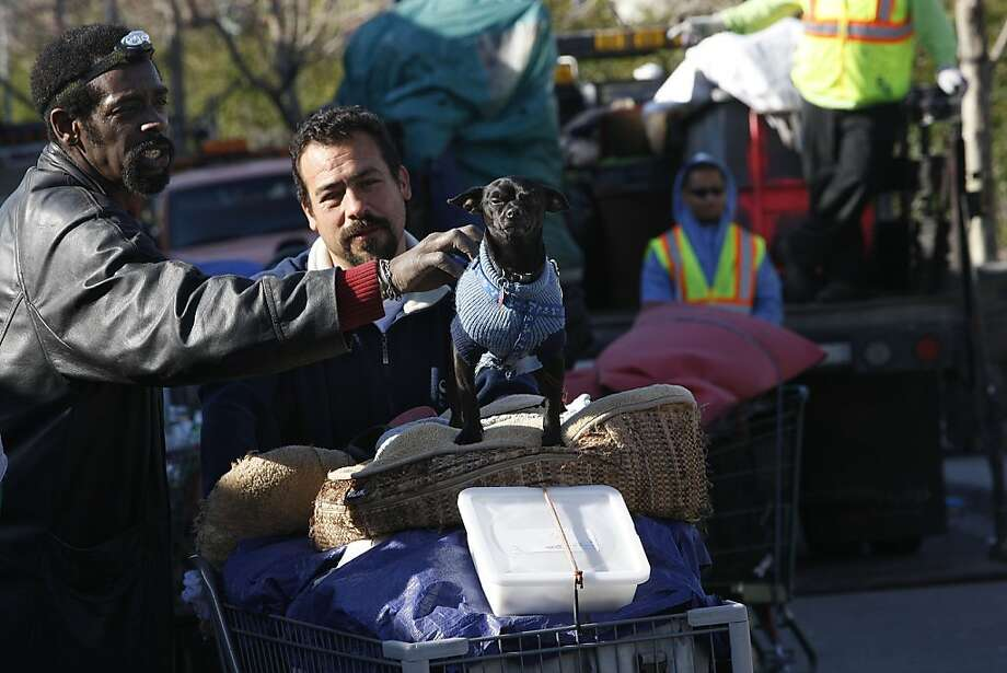 Tony Ford (left), dean of the homeless encampment beneath the Interstate 280 on-ramp in San Francisco, Calif., pets chihuahua/dobie Negro (middle) as they leave on Monday, March 11, 2013.   The encampment was forced to leave this morning with a permanent fence planned to keep the camp out of the area. Photo: Liz Hafalia, The Chronicle