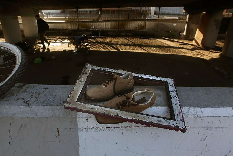 "A pair of shoes and a vintage frame belongs to Matthew ""Sticks"" Wells, 57 years old, at the homeless encampment beneath the Interstate 280 on-ramp in San Francisco, Calif., where he packed his belongings on Monday, March 11, 2013.   The encampment was forced to leave this morning with a permanent fence planned to keep the camp out of the area. Photo: Liz Hafalia, The Chronicle"