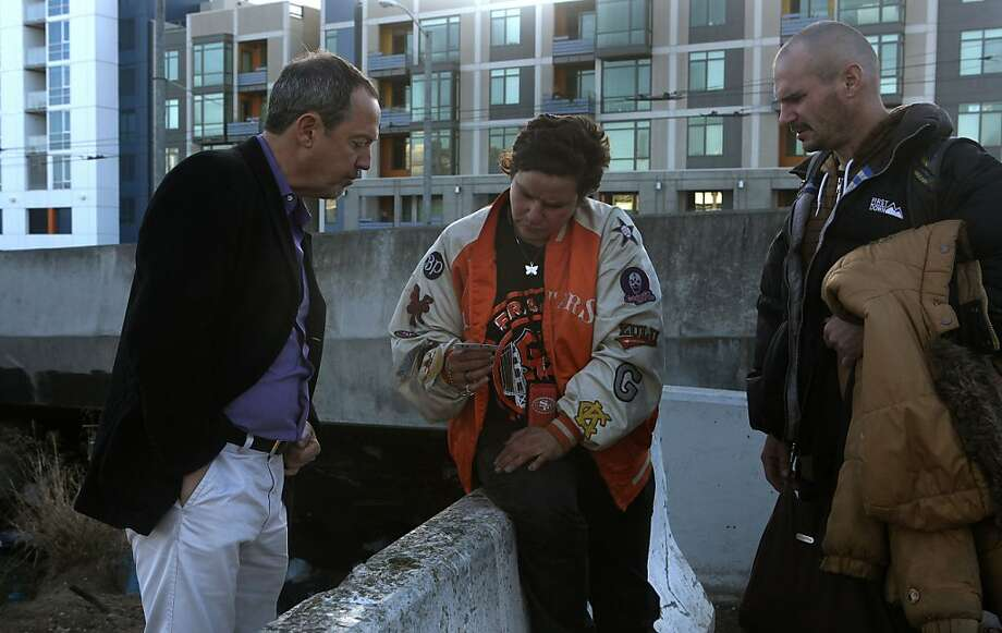 Former Supervisor Bevan Dufty (left) talking with Vanessa Romo (middle) and her boyfriend Kurth Reis (right) at the homeless encampment beneath the Interstate 280 on-ramp in San Francisco, Calif., on Monday, March 11, 2013.   The encampment was forced to leave this morning with a permanent fence planned to keep the camp out of the area. Photo: Liz Hafalia, The Chronicle