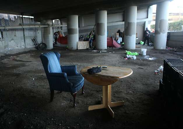A table and chair remain as the homeless encampment beneath the Interstate 280 on-ramp in San Francisco, Calif., get ready to leave on Monday, March 11, 2013.   The encampment was forced to leave this morning with a permanent fence planned to keep the camp out of the area. Photo: Liz Hafalia, The Chronicle