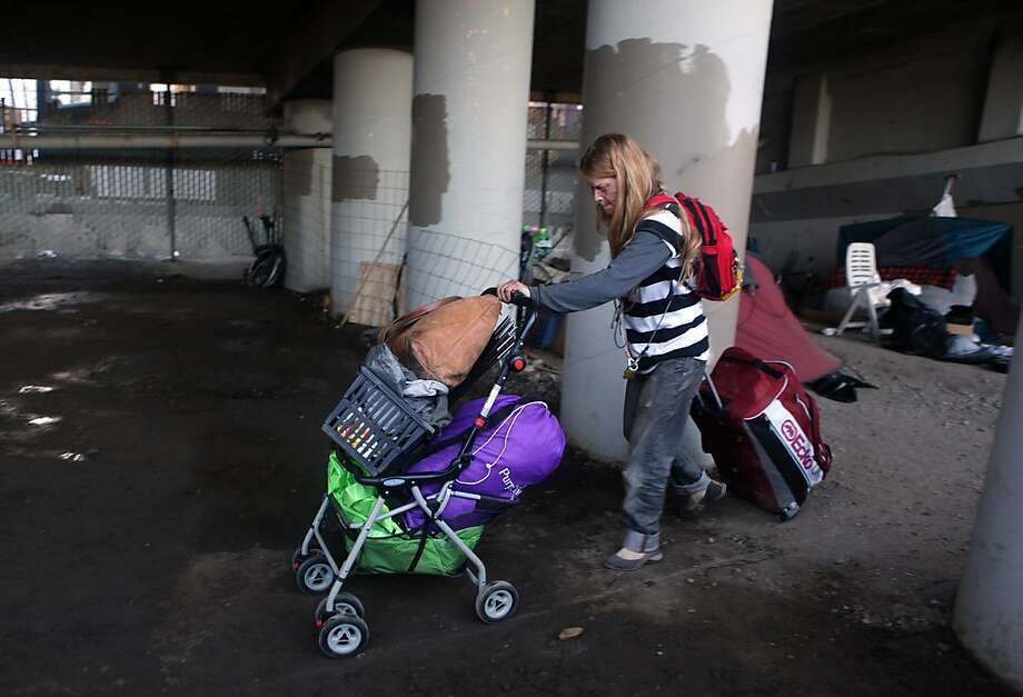 Jensina Hardig, 35 years old, leaves the homeless encampment beneath the Interstate 280 on-ramp in San Francisco, Calif., on Monday, March 11, 2013.   The encampment was forced to leave this morning with a permanent fence planned to keep the camp out of the area. Photo: Liz Hafalia, The Chronicle